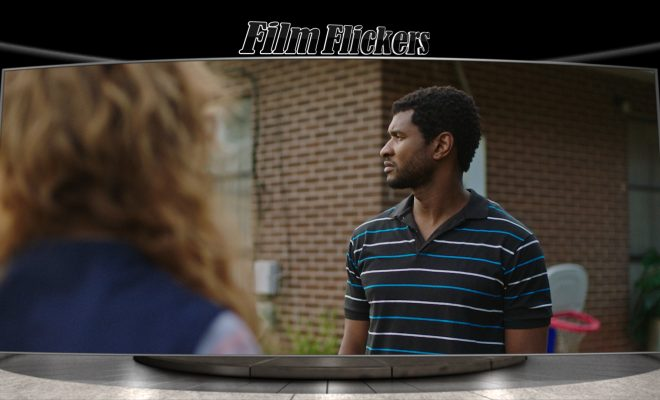 "Image of Usher looking off-camera while talking to a neighbor standing in front of camera in the film ""Burden"""
