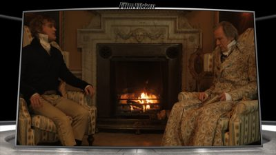 Bill Nighy and one of Emma's suitors talking and sitting in front of a fireplace