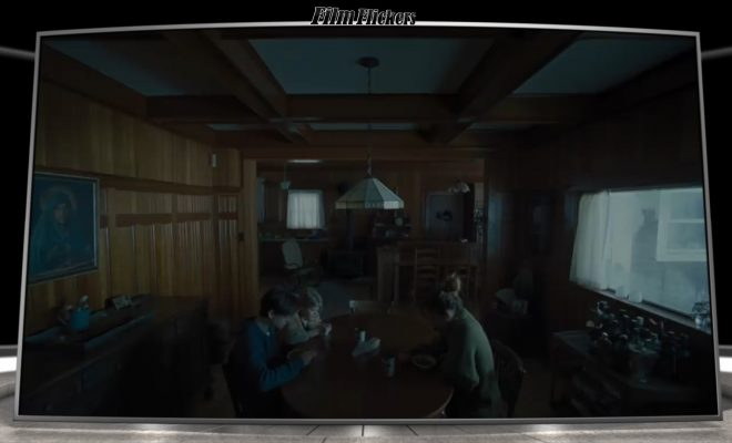 "Shot of the family of ""The Lodge"" sitting in their dining room, lit very gloomily"
