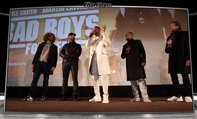 Will Smith, Martin Lawrence, Jerry Bruckheimer, and the directors of Bad Boys For Life on stage talking to an audience at a press event