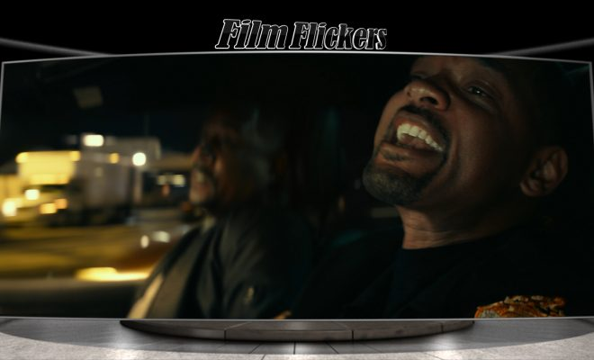 Shot of Will Smith and Martin Lawrence in the car together with Will Smith shouting out the window of the car