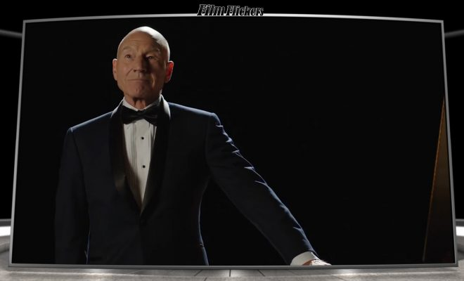 "Sir Patrick Stewart in a suit standing next to his piano in ""Coda"""