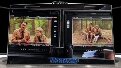 """Image of a 'Behind The Scenes' look of the film """"Jojo Rabbit"""" showing two monitors showing shots on set"""