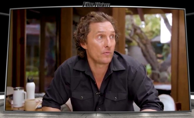 Image of Matthew McConaughey sitting on a chair in his backyard talking about the COVID-19 and practicing social distance