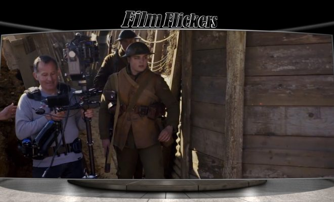 "Image of a 'behind the scenes' look of the film ""1917"" showing soldier running in the trenches while camera operator capturing from the left side"