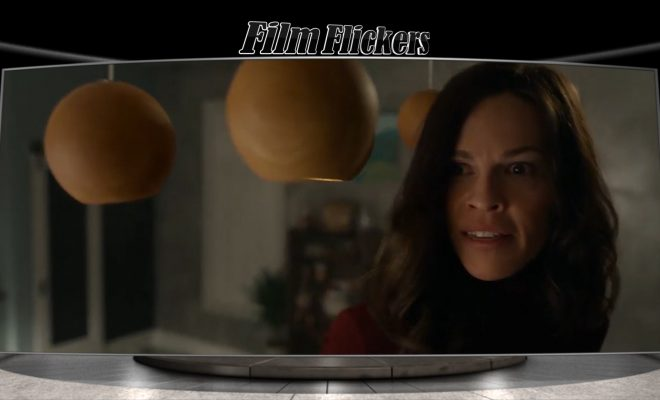 """Image of Hillary Swanks in the film """"The Hunt"""" looking surprise at someone off camera"""