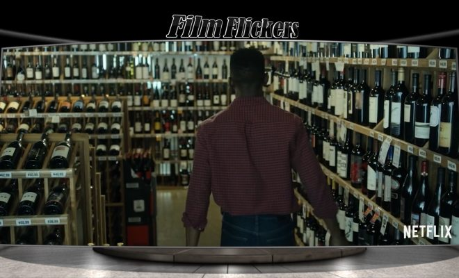 "Image of a man walking in a wine store, which is a scene from ""Uncorked"""