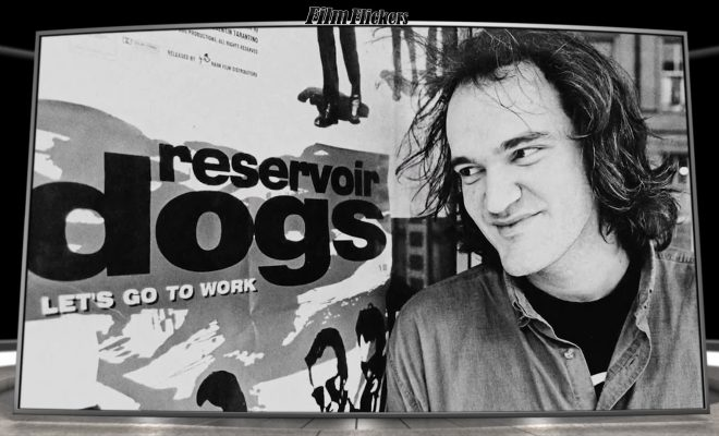 "Image of Quentin Tarantino looking at movie poster ""Reservoir Dogs"", which is a scene from the documentary ""QT8: The First Eight"""