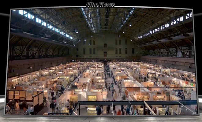 A wide shot of a convention for booksellers in a massive convention center