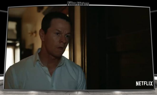 Mark Wahlberg standing in a room looking off screen