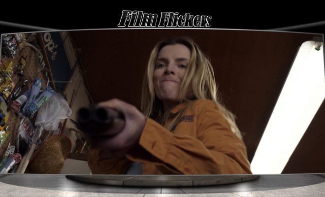 Betty Gilpin armed with a shotgun