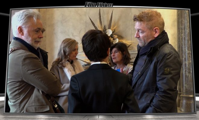 """Image of a behind-the-scenes look at the film """"Artemis Fowl"""" with story book writer talking with director Kenneth Branagh and lead actor Ferdia Shaw"""