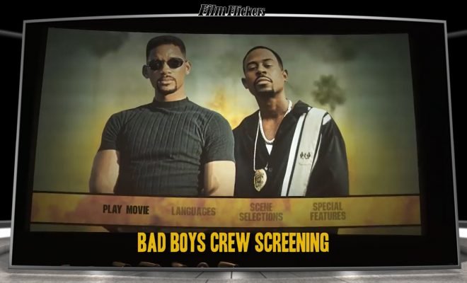 Image of a theater screen showing Martin Lawrence and Will Smith during a Bad Boys crew screening
