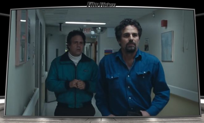 "Image of Mark Ruffalo playing twins walking out of a hospital from the TV series ""I Know This Much Is True"""