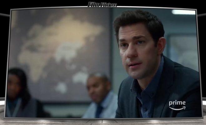 "Image of John Krasinski as ""Jack Ryan"" looking off camera in a meeting"