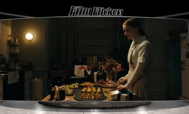 "Image of a nurse prepping dinner at a house in the film ""Saint Maud"""