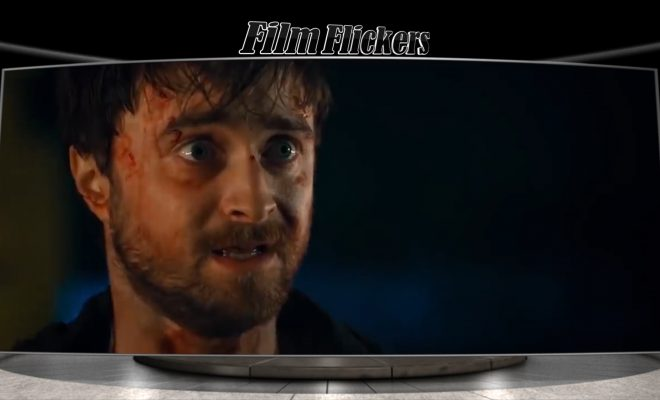 "Image of Daniel Radcliffe in the film ""Guns Akimbo"" looking off camera frightened"