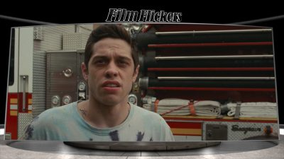 """Image of Pete Davidson looking up at something with a fire truck behind him in the film """"The King of Staten Island"""""""