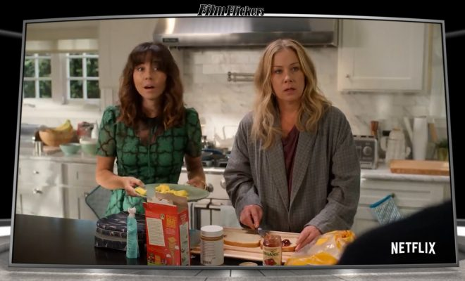 Image of two women in the kitchen looking frightened like they got caught