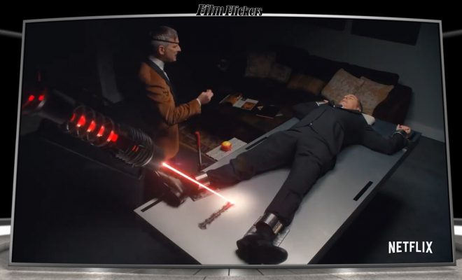 Image of Jerry Seinfeld strap to a table while a villain laughs on the side and a laser beam burning a line across the table, getting closer to Jerry