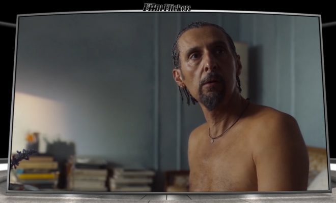 """Image of John Turturro shirtless looking up at someone in the film """"The Jesus Rolls"""""""