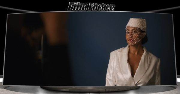 "Image of Tracee Ellis Ross as Grace Davis during a photo shoot in the film ""The High Note"""