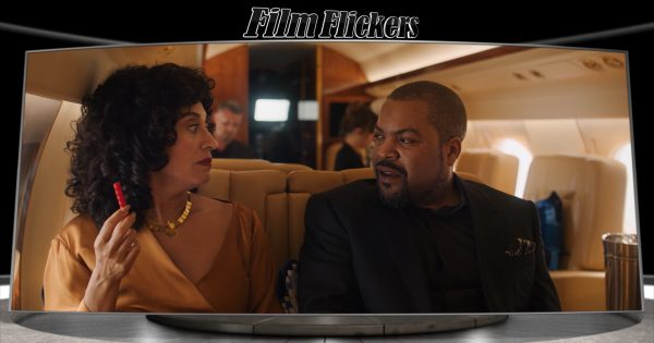 "Image of Tracee Ellis Ross and Ice Cube sitting in an airplane form the film ""The High Note"""