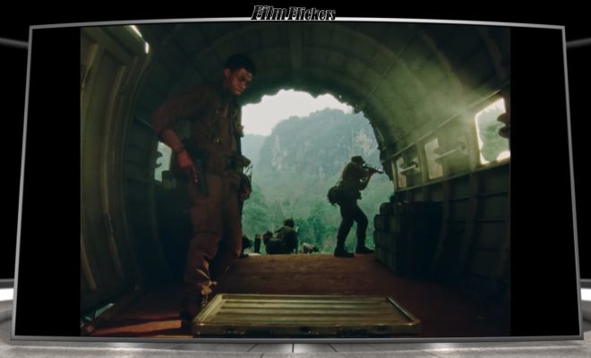 Image of Chadwick Boseman as a soldier inside a cave with another soldier guarding outside
