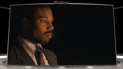 "Image of Michael B. Jordan looking off camera in front of a fire in the film ""Just Mercy"""