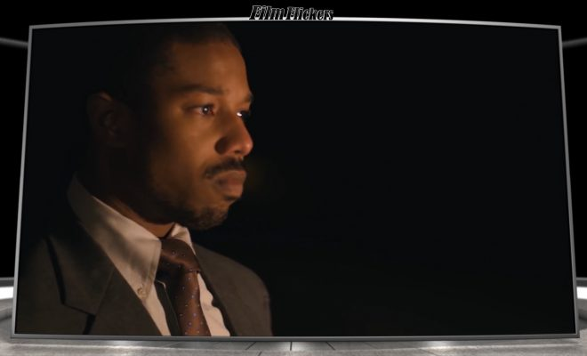 """Image of Michael B. Jordan looking off camera in front of a fire in the film """"Just Mercy"""""""