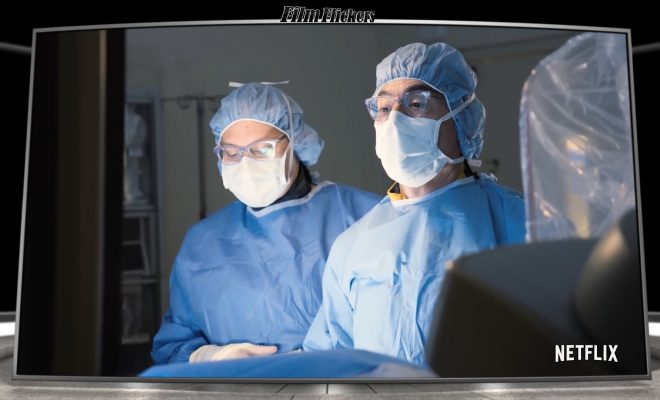 Image of doctors scrubbed up in a surgery room