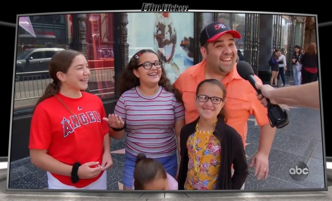 Image of a dad with his daughters getting interviewed for Jimmy Kimmel segment